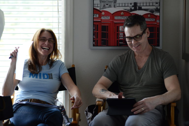 "Val and Matt share a laugh on the ""Into the Dark"" set."